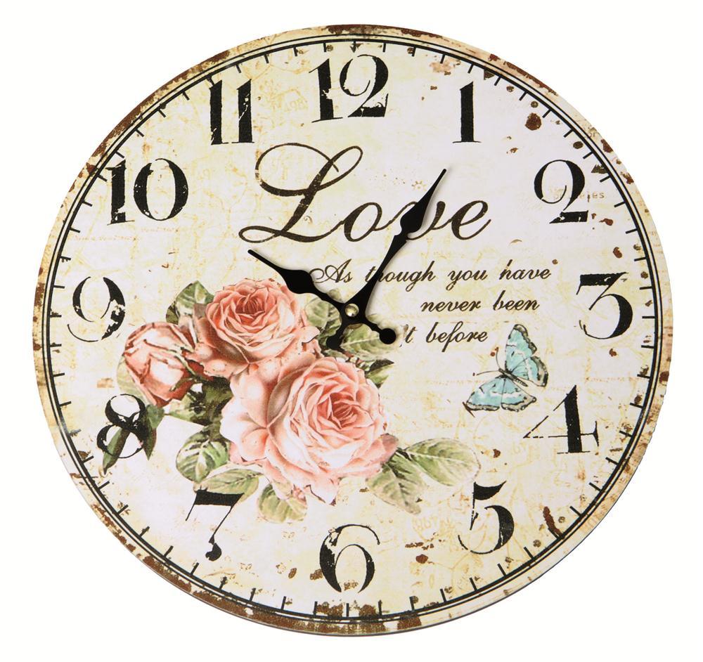 שעון קיר עץ עגול פרחים 29.99 שח