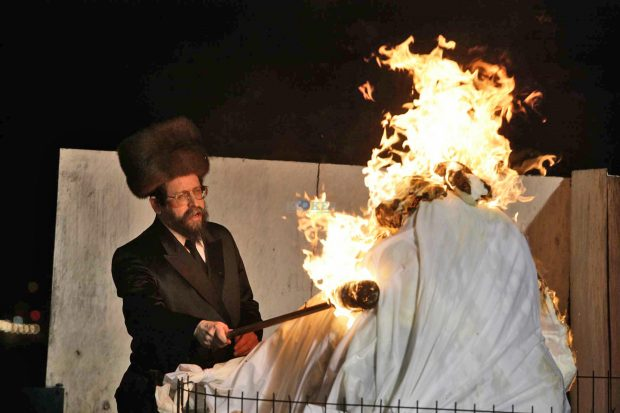Ultra Orthodox Jew cuts the hair of three year old boy during the celebration of the Jewish holiday of Lag Baomer in Mt Meiron