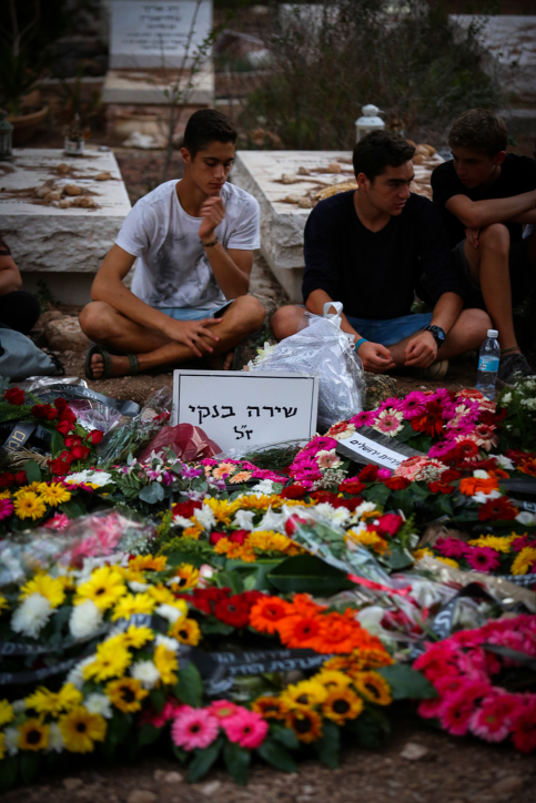 Friends of Shira Banki mourn around her grave following her funeral on August 03, 2015. 16-year old Banki was stabbed and critically wounded while participating in the Jerusalem pride parade last week, in an attack by ultra orthodox Jewish Yishai Schlissel, where five more were wounded. Banki passed away yesterday. Photo by Flash90  *** Local Caption *** ???? ???? ???? ??? ?????? ???? ???? ?????? ??? ????? ?????? ??? ??? ?????