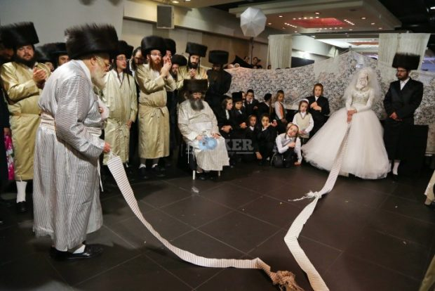 The granddaughter of the head Rabbi of Nachalat Aharon stands at the men's section and dances the Mitzva dance during her wedding at a hall located in Beit Shemesh, July 18, 2016. Photo by Yaakov Lederman/Flash90 *** Local Caption *** ????? ????? ??? ??? ???? ????? ??? ??? ????? ????